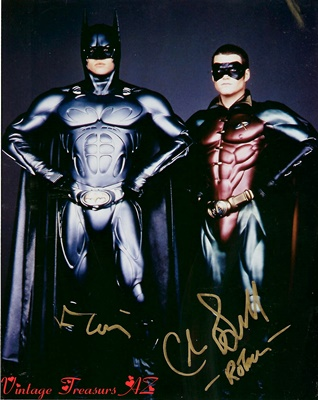 "Image for <b><span style='color:purple'> Batman Forever Autographed Val Kilmer & Chris O'Donnell ""Batman & Robin"" Movie Hand-Signed Color Photograph (TWO Autographs on Photo) </span></b><span style='color:purple'>  <b><span style='color:red'>***USPS FIRST CLASS MAIL SHIPPING INCLUDED – DOMESTIC ORDERS ONLY!***</span></b><span style='color:purple'>"
