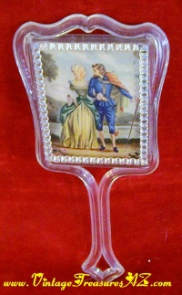 Image for Courting Couple Fragonard-esque Imagery Vintage ca 1950s-1970s Lucite or Acrylic Clear Plastic Hand-Held Vanity Mirror   <b><span style='color:red'>  ****PRIORITY MAIL SHIPPING INCLUDED – DOMESTIC ORDERS ONLY!*****  </span></b><span style='color:purple'>