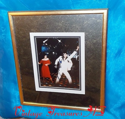 "Image for  <b><span style='color:purple'> Saturday Night Fever John Travolta Autographed Photograph Hand-signed Framed Color Movie Still Famous ""White Disco Suit Dance Floor"" Scene with Karen Lynn Gorney </span></b><span style='color:purple'>  <b><span style='color:red'>***USPS PRIORITY MAIL SHIPPING INCLUDED – DOMESTIC ORDERS ONLY!***</span></b><span style='color:purple'>"