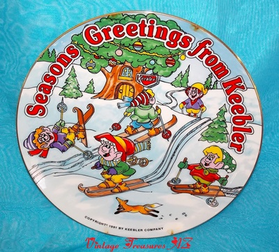 Image for  <b><span style='color:purple'> Keebler Elves Seasons Greetings from Keebler 1991 Christmas Plate Snow Skiing Elf Advertising Mascots Hollow Tree Factory Tree House Winter Holidays </span></b><span style='color:purple'>   <b><span style='color:red'> ***USPS PRIORITY MAIL SHIPPING INCLUDED – DOMESTIC ORDERS ONLY!***</span></b><span style='color:purple'>