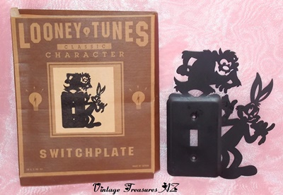 "Image for <b><span style='color:purple'> Looney Tunes Classic Character Switchplate ""Bugs Bunny & Tasmanian Devil (Taz)"" Black Metal Light Switch Plate/Light Switch Cover in Original Box (New-Old-Stock 1994 Warner Bros) </span></b><span style='color:purple'>   <b><span style='color:red'>*****USPS FIRST CLASS SHIPPING INCLUDED – DOMESTIC ORDERS ONLY!*****</span></b><span style='color:purple'>"